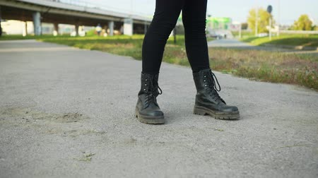 cipőfűző : Teenager Stand Motionlessly Feet View City Street. Person Stock-still Position Black Lace-boots Wear Immobility Pose. Leather Footwear Urban Asphalt Highway Background Lifestyle Concept Stock mozgókép