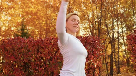 aerobic : Beautiful woman training ballet pas on outdoor class in autumn park. Ballet woman group training choreography exercise in city park. Fit woman practicing port de bras