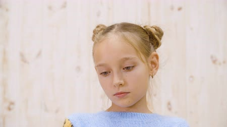 insatisfecho : Portrait of beautiful upset little girl looking down. Close-up view of unhappy resentment teenage girl with sad facial expression standing and looking down Archivo de Video