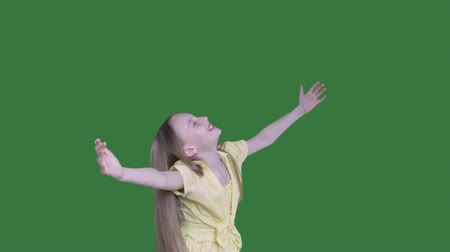 tenso : Happy girl teenager with raised hands twisting on transparent background. Smiling girl with stretching hands enjoying cheerful mood. Alpha channel, keyed green screen Vídeos