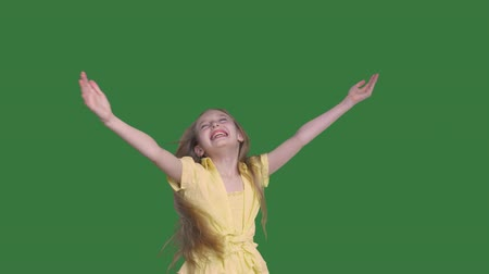 áttekinthetőség : Beautiful happy teenage girl raising hands and twisting. Adorable cheerful teenage girl with long hair raising hands and looking up on transparent background with alpha channel Stock mozgókép
