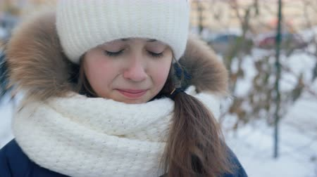 maltreatment : Portrait upset young girl crying on winter street. Close up face unhappy girl crying on winter walk at snowy city street Stock Footage