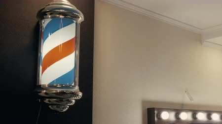 Barber pole sign spinning. Retro style barber shop sign. Barber shop concept