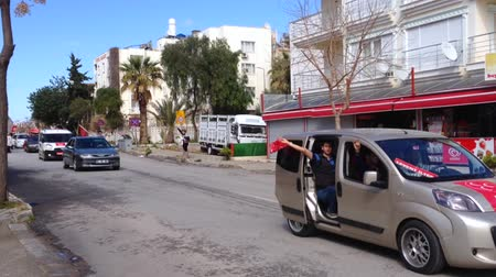 akp : DIDIM, TURKEY - MARCH  2, 2014 :  Local elections campaign of the AK Party supporters. Election rally by cars and trucks