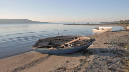 ascetic : Empty small wooden boats on the beach. 4k