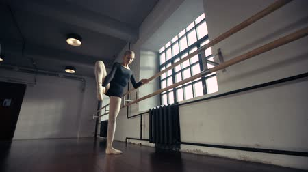 esneme : Female Ballet Dancer stretches and practices,dolly shot Stok Video