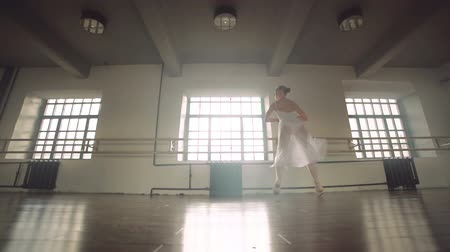 leaping : graceful girl practicing ballet in the Studio, slow motion , does pirouettes Stock Footage