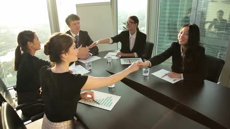 projects : young business partners greet each other before meeting