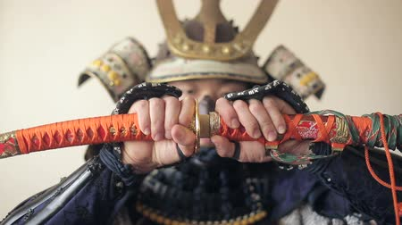 replace : ancient Japanese samurai opens up his sword, close-up