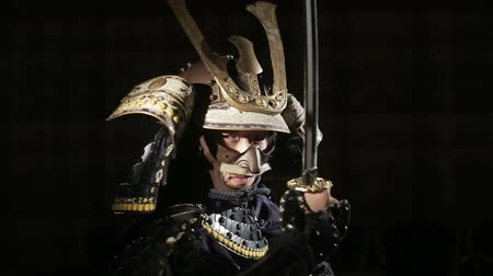 frightful : samurai with a sword comes out from the darkness Stock Footage