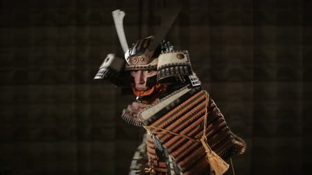 replace : European man in the way of the samurai threatens the opponent