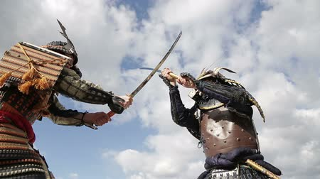 felsefe : fight two Japanese samurai in the background of sky with clouds closeup