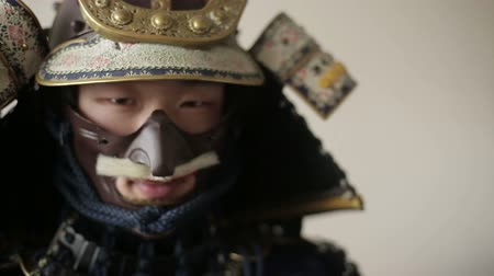 frightful : ancient Japanese samurai menacingly posing, close up, white background Stock Footage