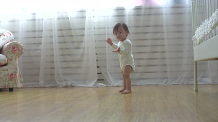 single shot : one year a small asian baby taking its first steps,dolly shot