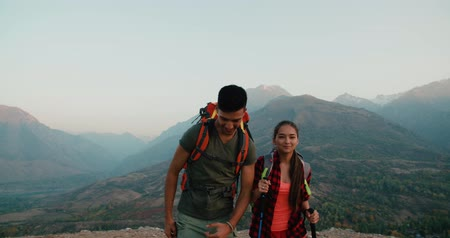 self portrait photography : young asian couple of tourists doing selfie reaching the top of the mountain