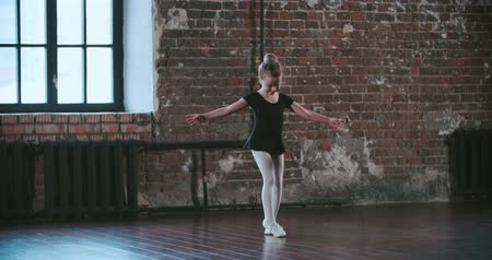 squatting : little girl dreams of becoming a ballerina, and makes no attempt to implement elements of the ballet