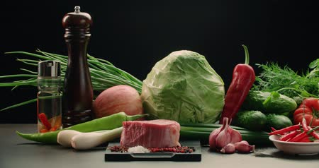 sirloin : beautiful composition of vegetables, meat and spices on the table, products for cooking Asian dishes, dolly shot