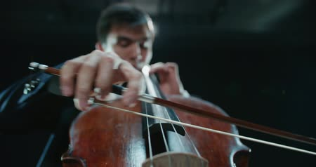 outstanding : asian cellist male solo classical music performance, close-up