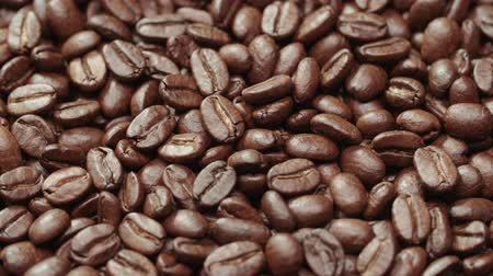 restaurante : beautiful background of roasted coffee beans rotating in slow motion