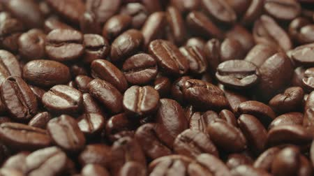 restaurante : beautiful background of roasted steaming coffee beans which rotate in slow motion Stock Footage