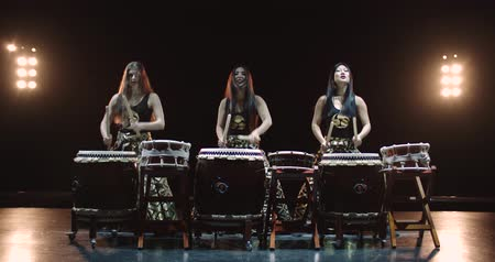 taiko drums : very epic performance of three Japanese Taiko drummer on stage, with sound,various rhythm