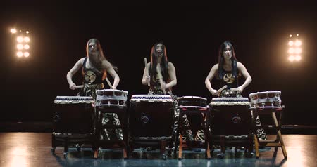 musical intrument : very epic performance of three Japanese Taiko drummer on stage, with sound,various rhythm