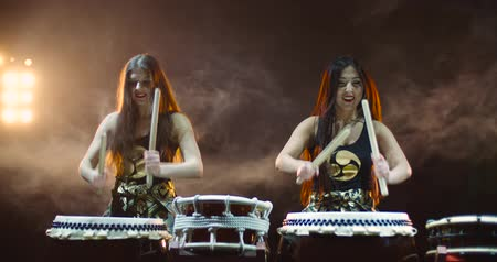 musical intrument : very epic performance of two Japanese Taiko drummer on stage, with sound,various rhythm
