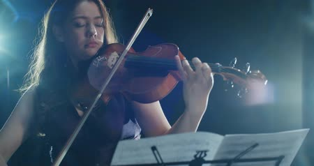 fuvolák : beautiful young girl playing the violin during the concert