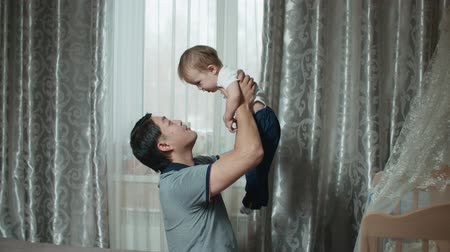 paternal : happy Asian family scene, the kid is having fun on his fathers hands Stock Footage