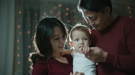 archívum : Asian couple with a little baby on their hands, happy family moments, slow motion