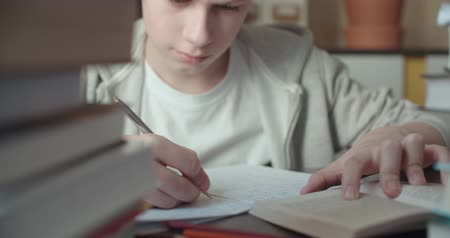 diligence : 4k,Teenage boy studying - doing his homework,dolly shot, close up Stock Footage