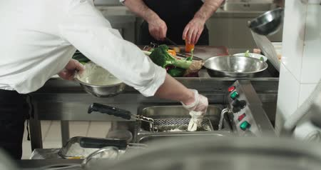 organizing : backstage workflow in the kitchen of the restaurant, the team of Asian chefs work with vegetables, cooking vegetarian dishes Stock Footage