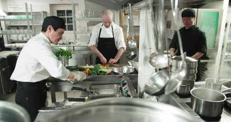 organizing : the workflow in the kitchen of the restaurant,a team of Asian chefs prepare dishes