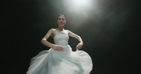 tiptoe : 4K video footage beautiful elements of classic ballet ballerina dancing on black background, slow motion Stock Footage