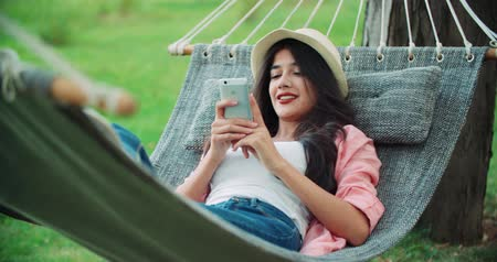 hayat : beautiful girl with a smartphone on the gammack, enjoy life