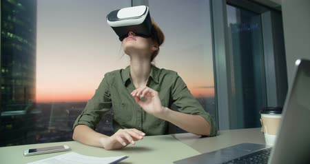 exited : Technology VR-businessman young girl wearing virtual reality technology VR Glasses to work in modern office in a skyscraper. the creation of the presentation Stock Footage