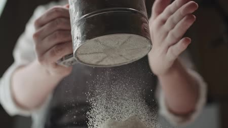 sieving : closeup of the chef sifts flour for kneading dough , slow motion Stock Footage