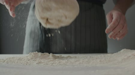 taneli : 4к Baker kneading dough in flour on table, slow motion,close up Stok Video