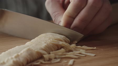 taneli : 4K the chef cuts the dough for spaghetti, slow motion
