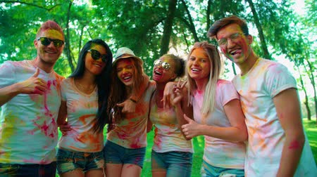 mob : company of young of different nationality friends having fun in the Park after the festival of paints Holi
