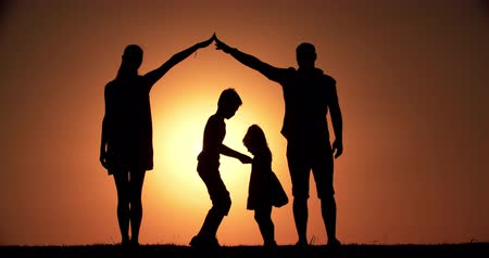 advert : 4K, home concept, family silhouette father, mother, two children, dream of buying a house, playing in the background of the sunset, slow motion Stock Footage