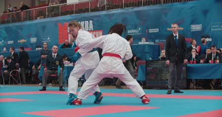 каратэ : MOSCOW - March 11, 2017,the arena Sambo-70, the Cup of Russia on karate: two women, girls fight in the Kumite, slow motion