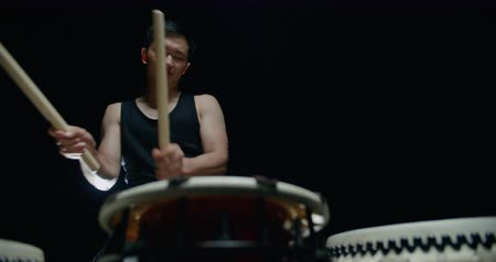 gagaku : performance of Taiko , Asian male drummer in black clothes, beats a rhythm on three Japanese drums Stock Footage