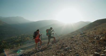 turk : Hikers people hiking - healthy active lifestyle. Hiker people hiking in beautiful mountain nature landscape. Woman and man hikers walking during trekking hike.steadycam shot Stock Footage