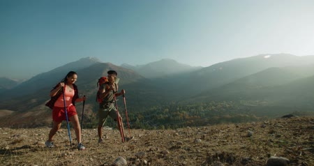 turk : young active Asian couple travelling in the mountains during their honeymoon, Steadicam shot