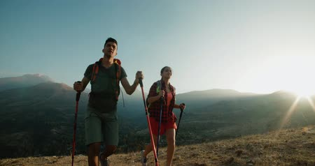 turk : young Asian couple Hiking in the mountains on Sunny day, steadycam shot Stock Footage