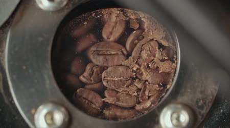 tasting : 4k, slow motion,the freshly roasted coffee beans from a large coffee roaster Stock Footage