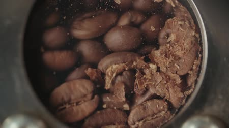 roaster : 4K, close up slow motion mixing roasted coffee beans in roaster machine