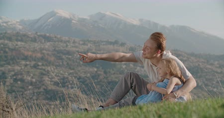 family idyll concept, young happy father with little daughter, have fun in beautiful mountain place, slow motion, dads day Стоковые видеозаписи