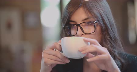 young beautiful girl drinking coffee in a cafe 4k Wideo